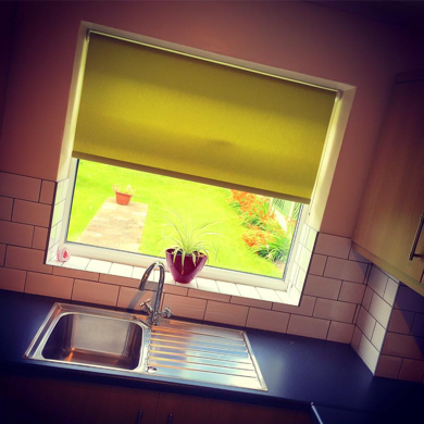 yellow roller blind fitted in kitchen