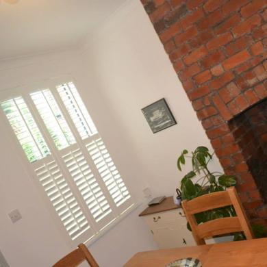 tier on tier shutters in dining room
