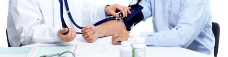 Doctor checking blood work and blood pressure from patient