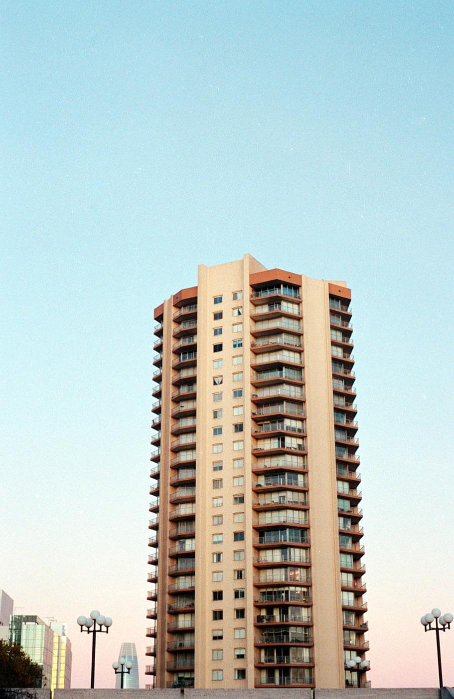 Apartment on Gough in front of a blue-pink gradient sunset