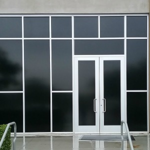 Blackout window tint on commercial building.