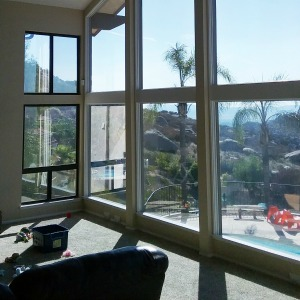 Image of reflective window film on residential building.