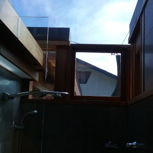 Photo of overhead glass in shower being tinted to reduce incoming heat.