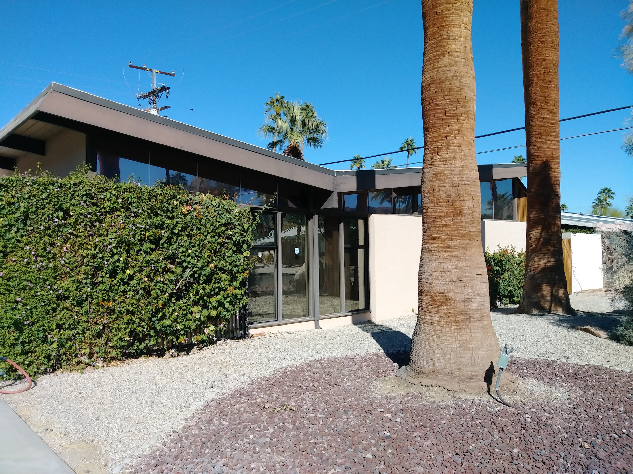 Picture of a business in Palm Springs CA supplied with tint to reduce heat and glare.