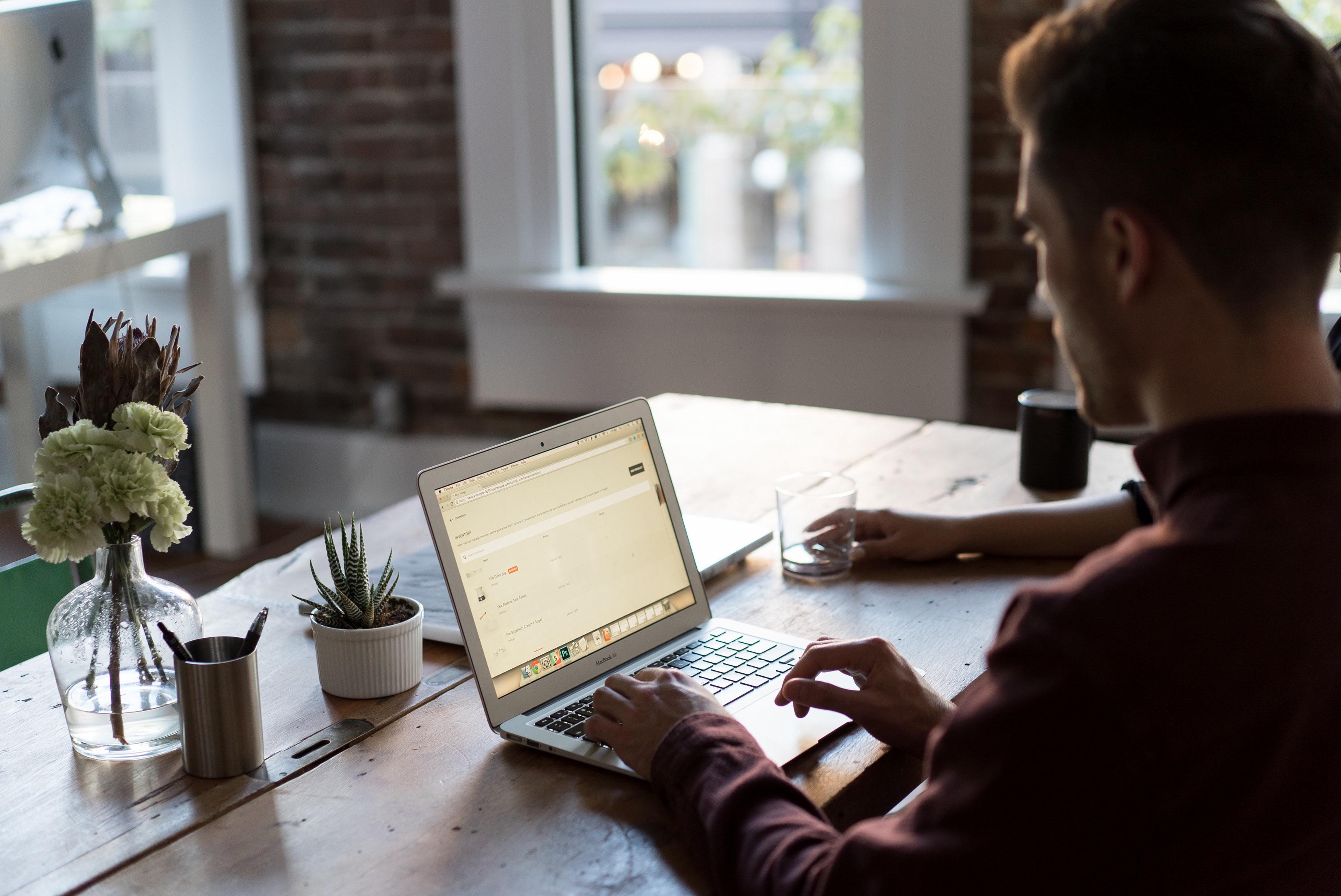 Man on laptop researching affiliate programs