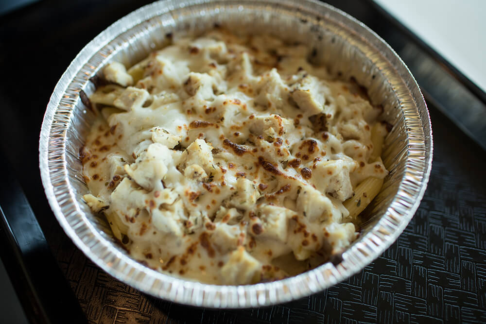 The chicken Alfredo is topped generously with white meat chicken, covered with creamy and flavorful Alfredo, sprinkled with cheese and nicely toasted before serving. (Photo: Valerie Grant)