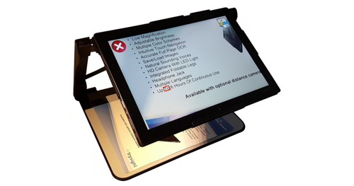 "A 12"" touch screen tablet with its own stand. Adjustable to be an elevated and flat surface. A camera can scan documents on the base below for text to speech."