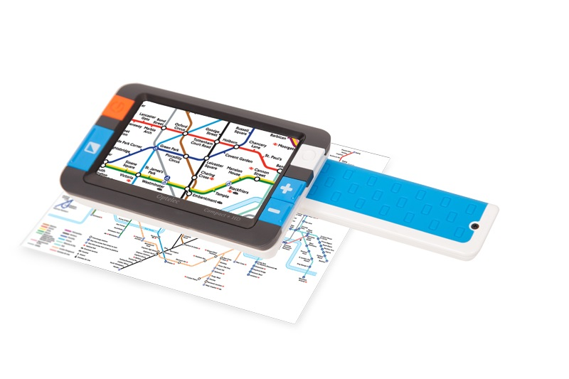 Compact+ HD with handle open. Device powered on and shown on a paper map.