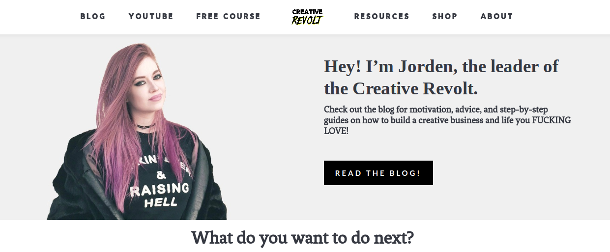 Jorden Roper with pink hair and black clothes on the left and her site copy and a CTA on the right