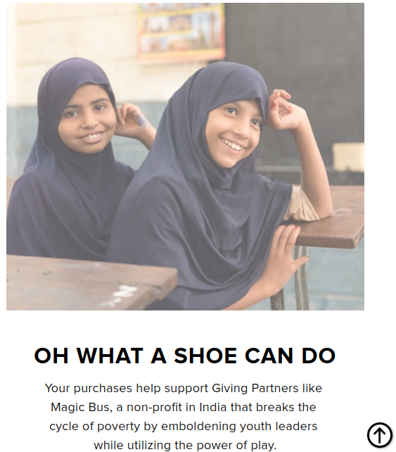 Two school-aged girls smiling at their desks wearing Hijabs with copy about proceeds from the purchase of shoes goign to the Magic Bus charity in India