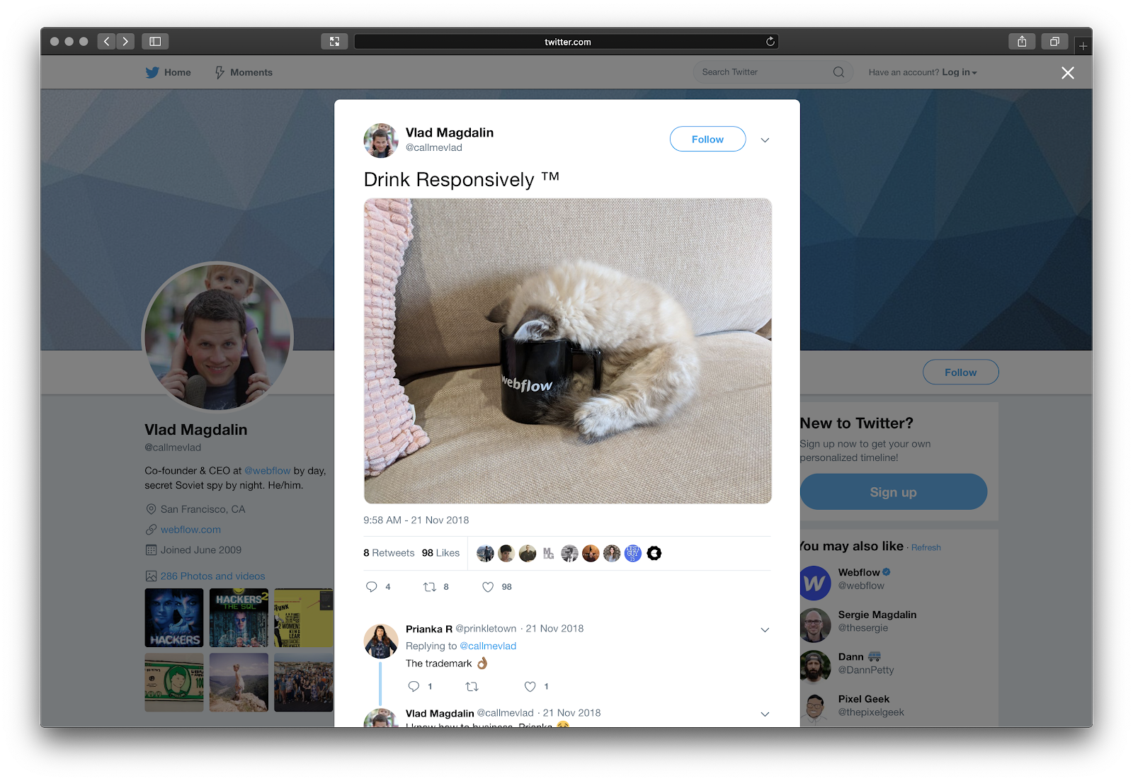 "Tweet by Vlad Magdalin with a picture of a kitten with its head in a Webflow branded mug and a caption that says, ""Drink Responsively"""