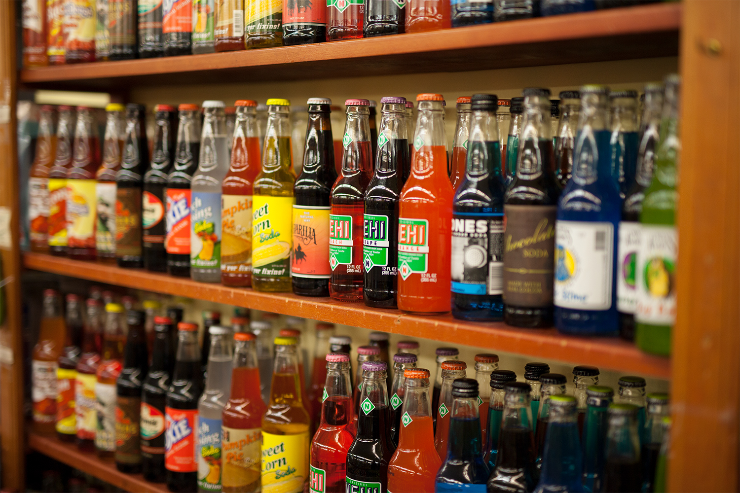 shelf full of soda flavors