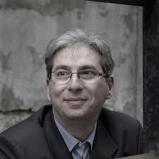 A photograph of Hungarian writer Gábor Schein