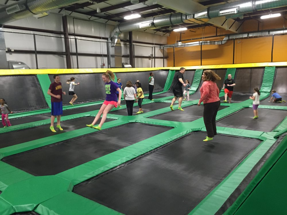 people jumping on large trampoline at rockin' jump