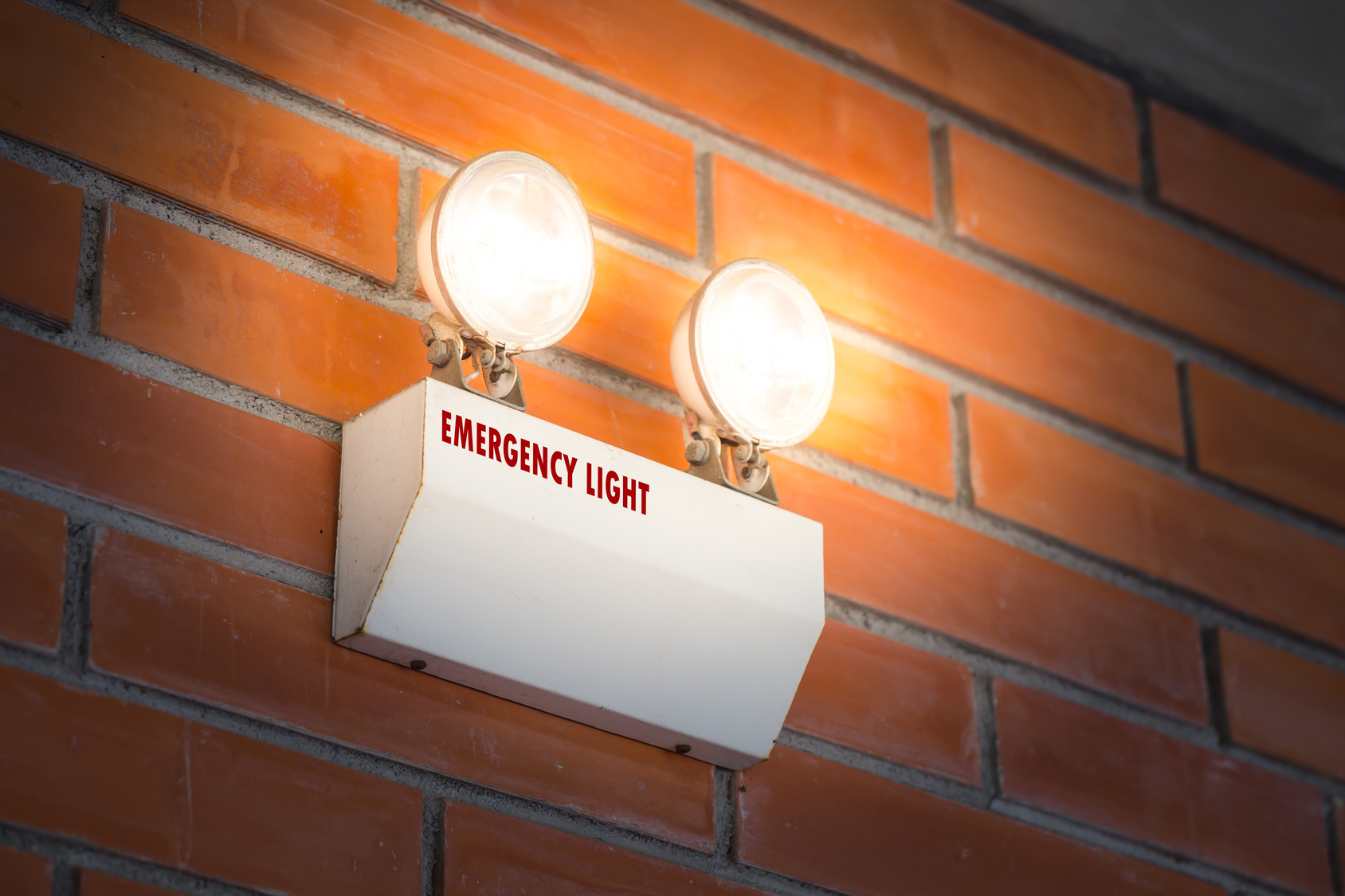 An emergency light warns that the power is out.