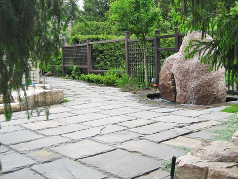 The feature stones, paving and fencing were each chosen to blend perfectly with the property
