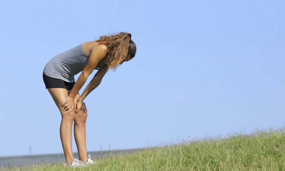 Woman jogger tired in field
