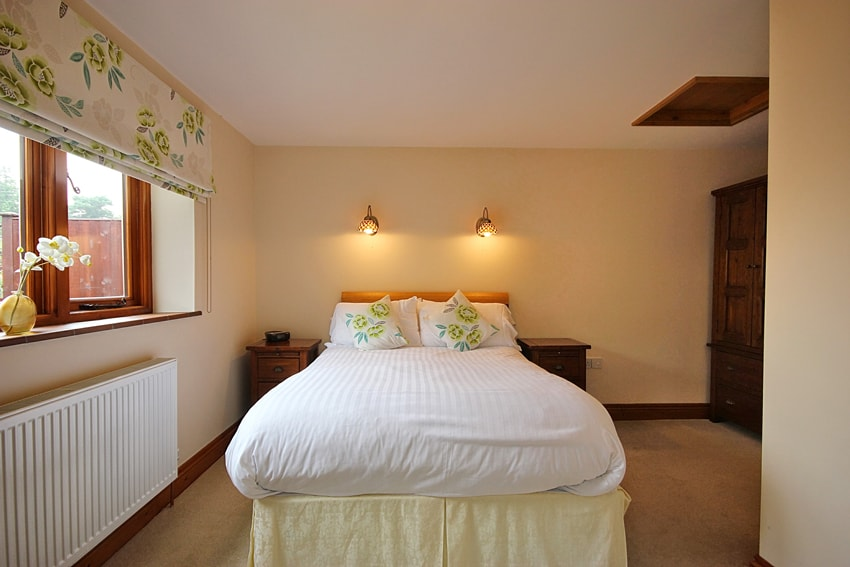 Bedroom in Malthouse Holiday Cottage