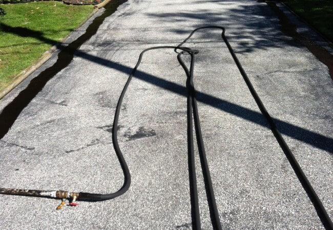 Driveway before Gem asphalt sealing service