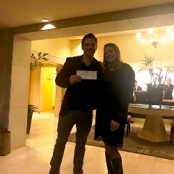 Jennifer Pochedly presenting $1,500 donation to 2 Hands 2 Cans