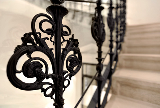 Detail photography of intricate, black banister from 	Palais Hansen Kempinski Vienna in Austria