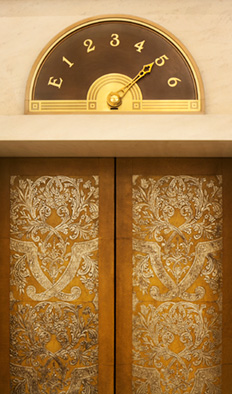Detail photography of the outside of a gold elevator from Hotel Adlon Kempinski in Germany