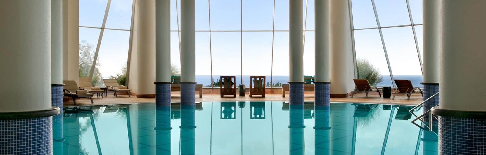 Architectural photography of indoor pool and lounge chairs from Kempinski Hotel Barbaros Bay in Turkey