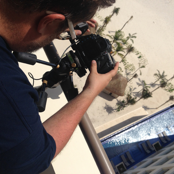 Behind the scenes photographer setting up shot at Playa Hotels and Resorts - Cancun