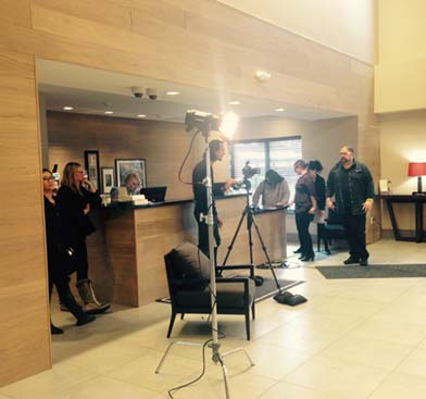 Behind the scenes of photo shoot for Country Inn and Suites airport advertisement