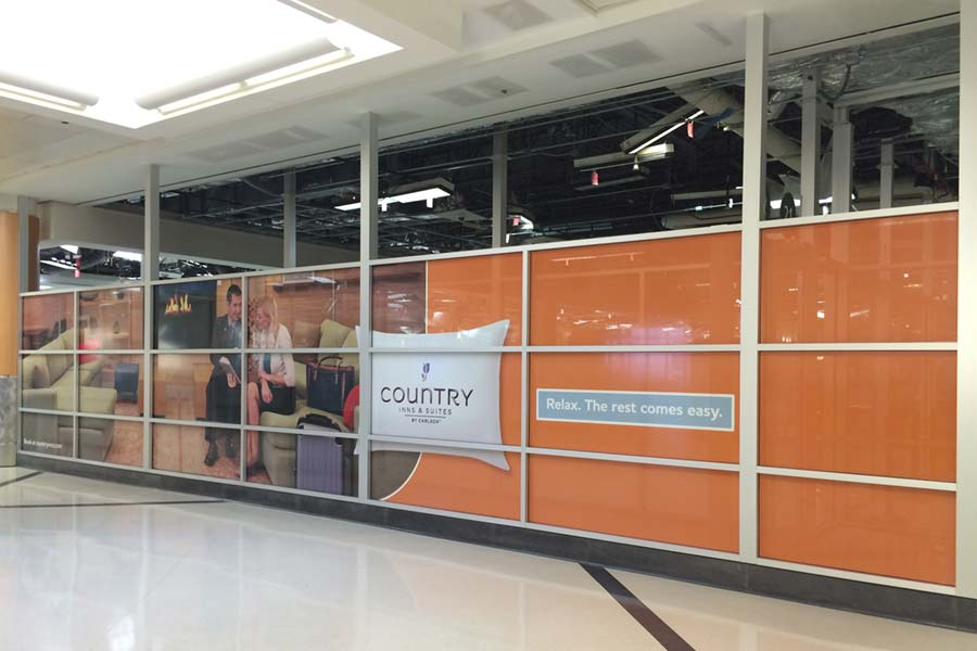 Country Inn and Suites advertisement at airport