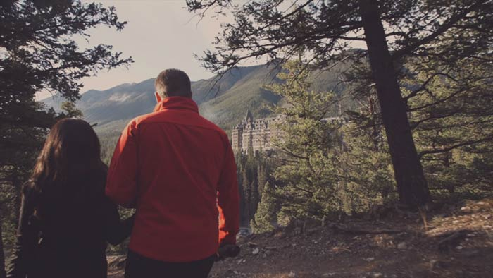 Couple walking through forest in Fairmont's Love Letter to Canada video