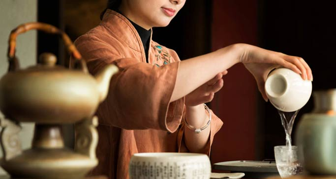 Aspirational photography of tea service with model at Kempinski Hotel Fuzhou