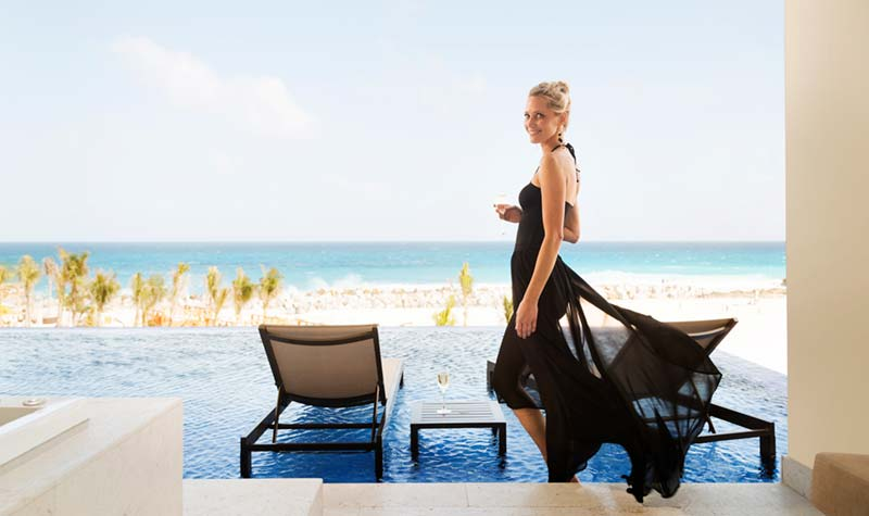 Hyatt Ziva Cancun lifestyle photography of woman in black dress in the Swim Up Suite