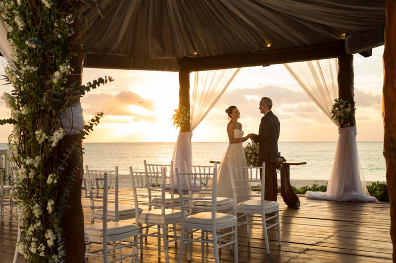 The Royal Playa del Carmen lifestyle photography of bride and groom at Wedding Gazebo