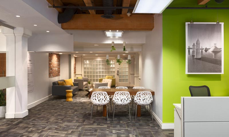 VRX Studios' office space photography of main entrance, lounge area and dining area
