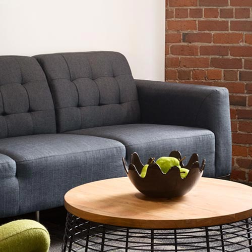 VRX Studios' office space photography of couch and coffee table