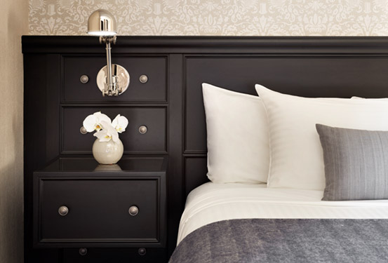 Detail photography of king bed and night stand at The Cosmopolitan Hotel TriBeCa