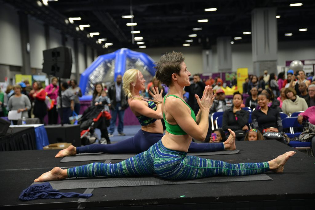 woman doing yoga at a convention