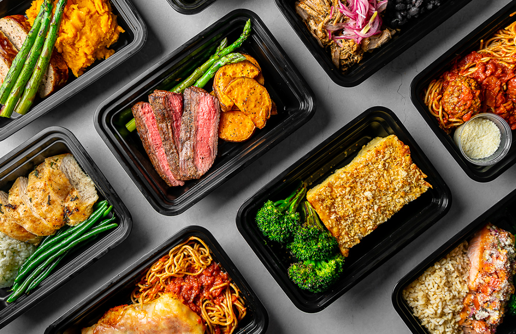 Grid of various meals in takeout containers