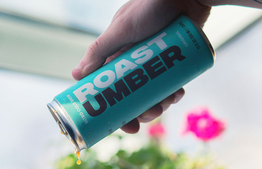Roast Umber nitro cold brew pouring into glass.