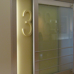 door of healthcare facility with room number