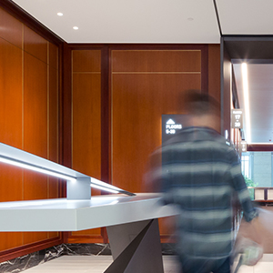 lobby of a commercial office with man walking past