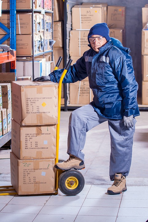 guy stacking boxes