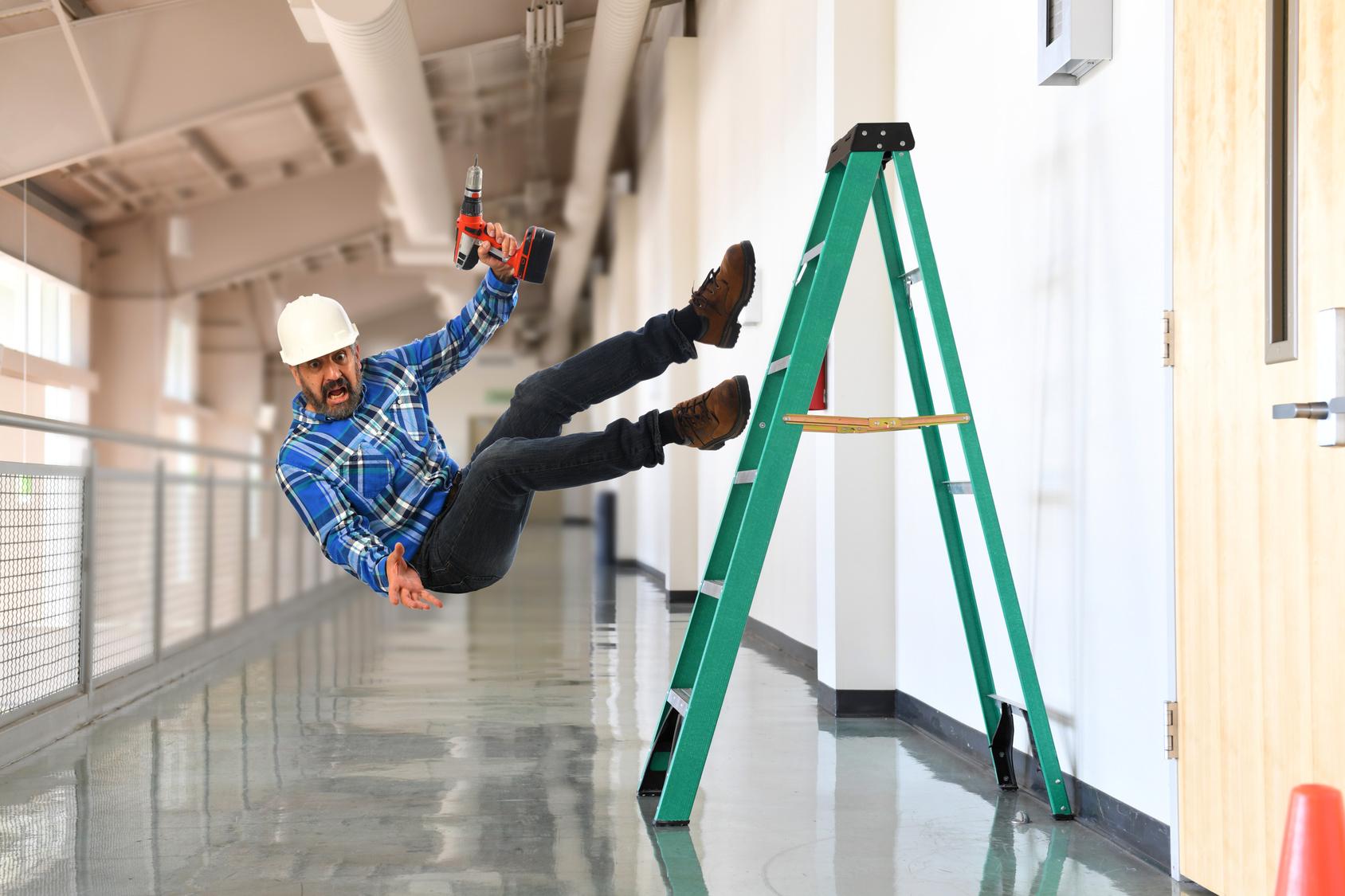 Worker falling off laddar