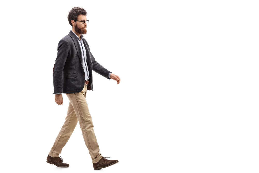 Guy walking across white background