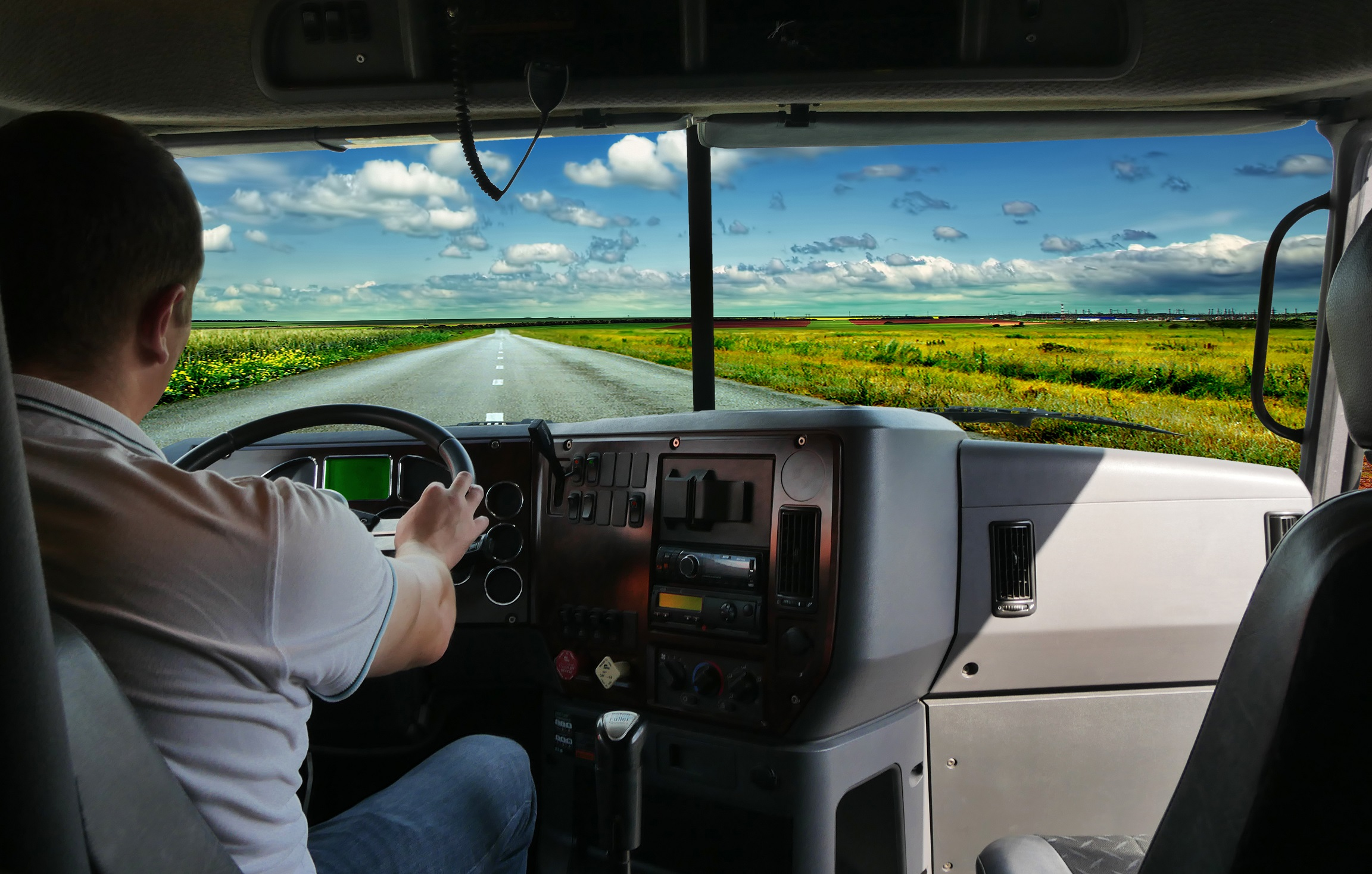 Guy driving a truck interior