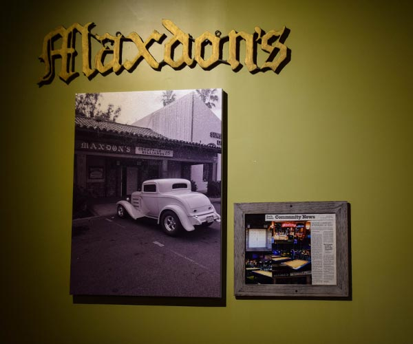 Photo of a sign that says Maxdon's and two framed historical photos.