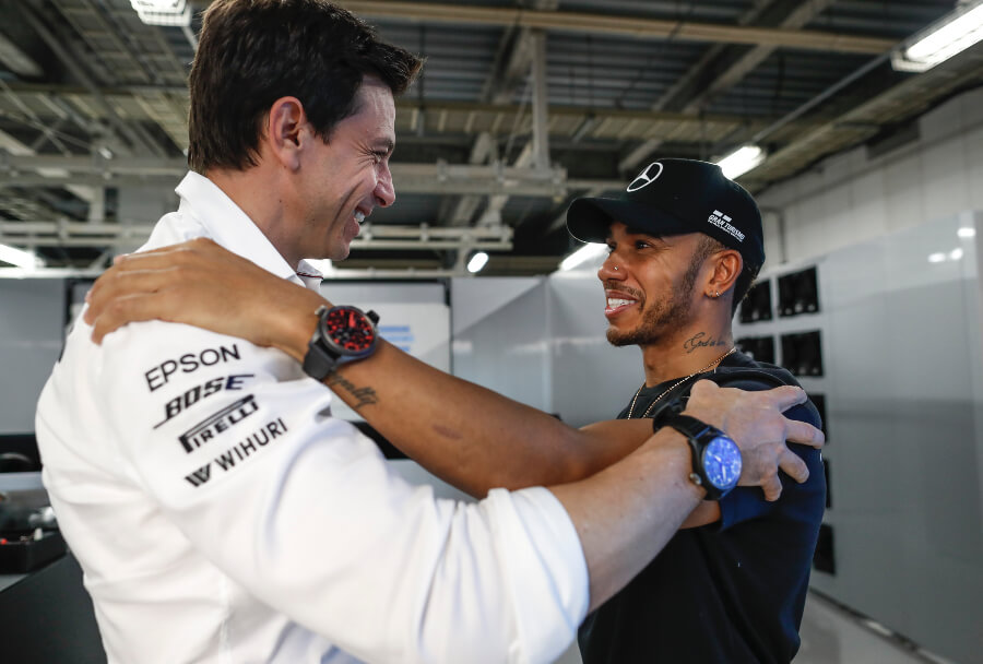 """Lewis Hamilton wearing the Pilot's Watch TOP GUN Perpetual Calendar """"Boutique Edition"""" (IW502903) with Toto Wolff"""