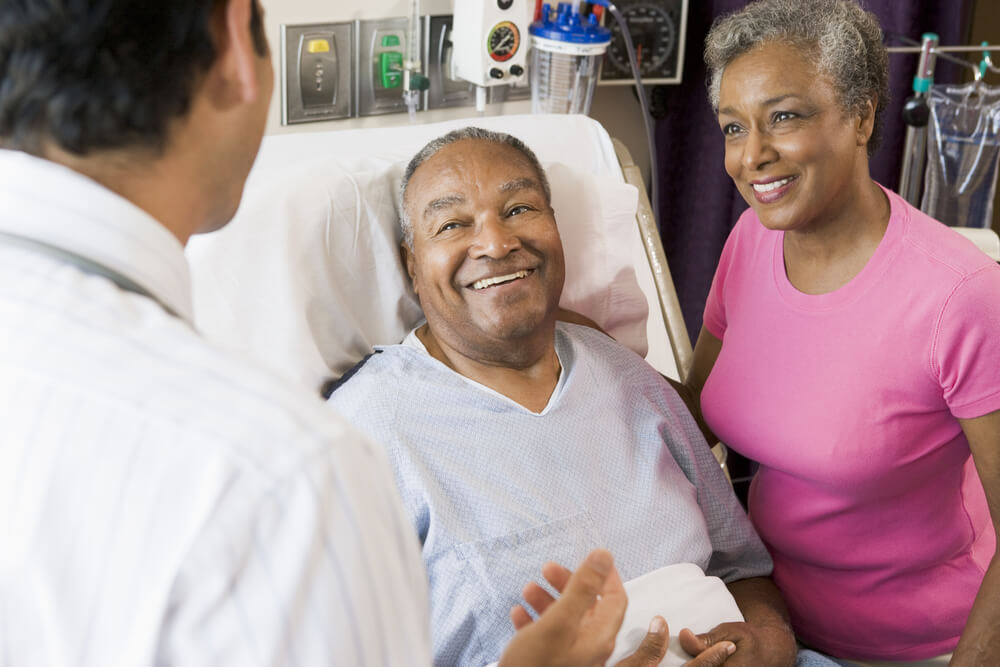 A patient and his wife speaking with a doctor