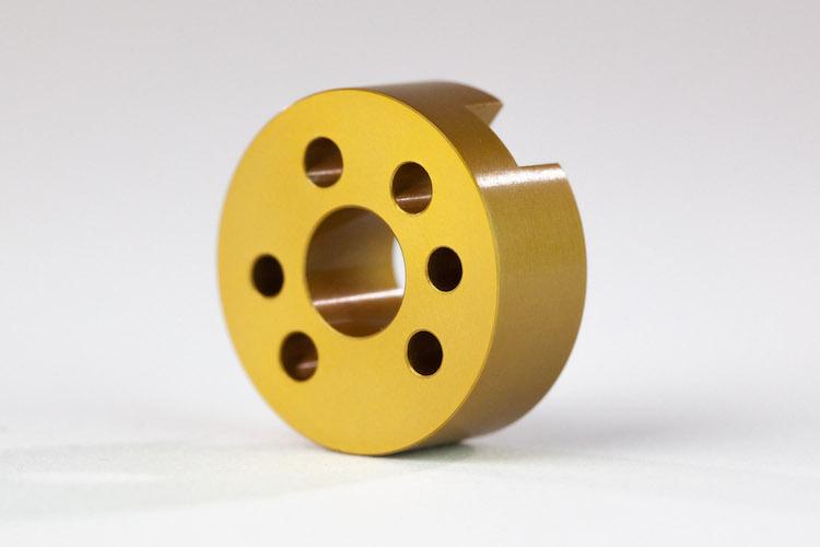 gold anodized cnc part